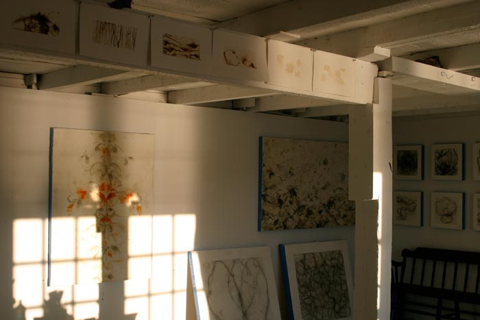 Betsy Eby's studio with encaustic paintings.