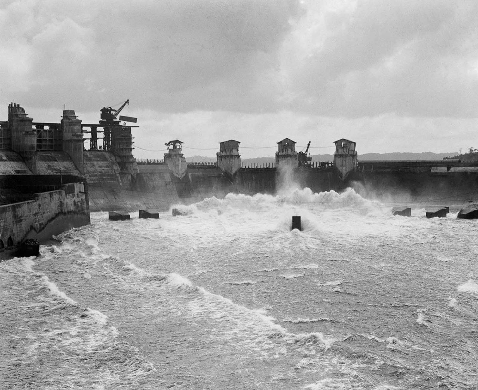 The spillway of the Gatun Dam, which impounds manmade Gatun Lake, a major section of the canal. 1913.