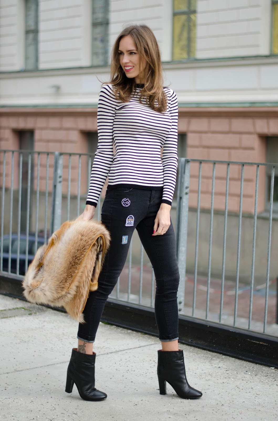 kristjaana mere striped jumper jeans with patches ankle boots spring outfit