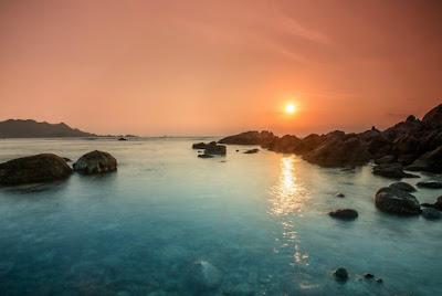 Watching sunrise at near morning at Binh Ba
