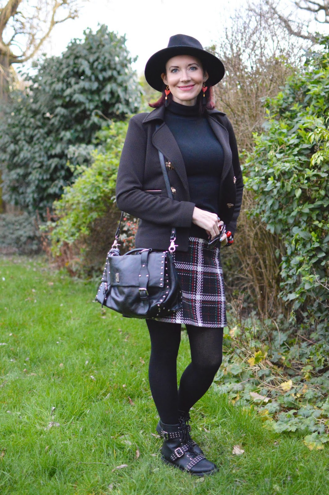 Looking stylish in studded boots, check skirt, hat and amazing bag from Pom Amsterdam is over 40s blogger Emma Peach from Stylesplash