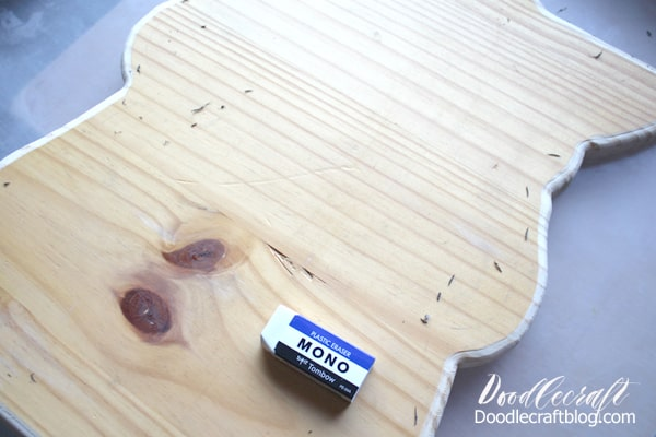 Use a Tombow MONO eraser to erase the pencil lines from the baby Yoda outlined wood cut out.