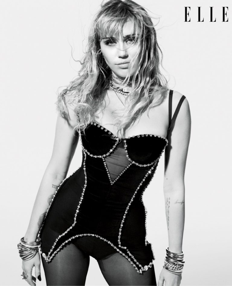 Singer Miley Cyrus wears Burberry corset and Wolford tights