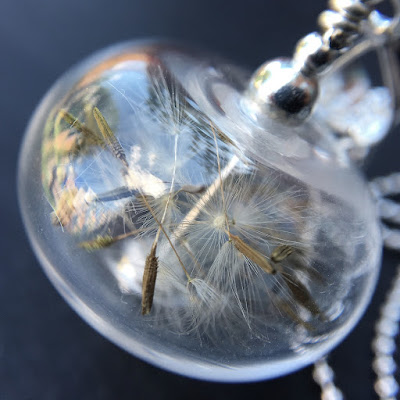 Lampwork glass bead and sterling silver necklace filled with dandelion clock seeds