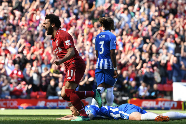 Mohamed Salah of Liverpool celebrates after scoring his sides first goal during the Premier League match between Liverpool and Brighton and Hove Albion at Anfield on May 13, 2018 in Liverpool, England.