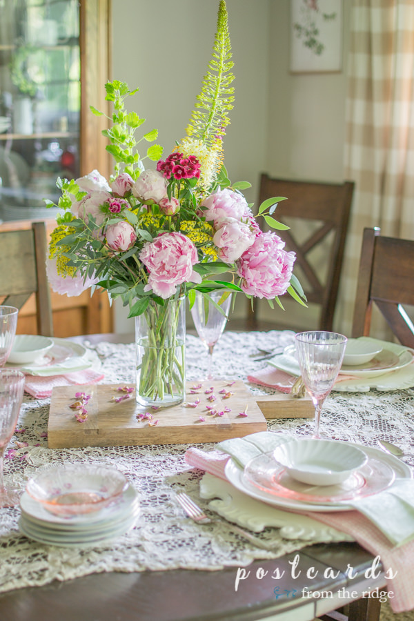 pastel tablescape with pink peony centerpiece