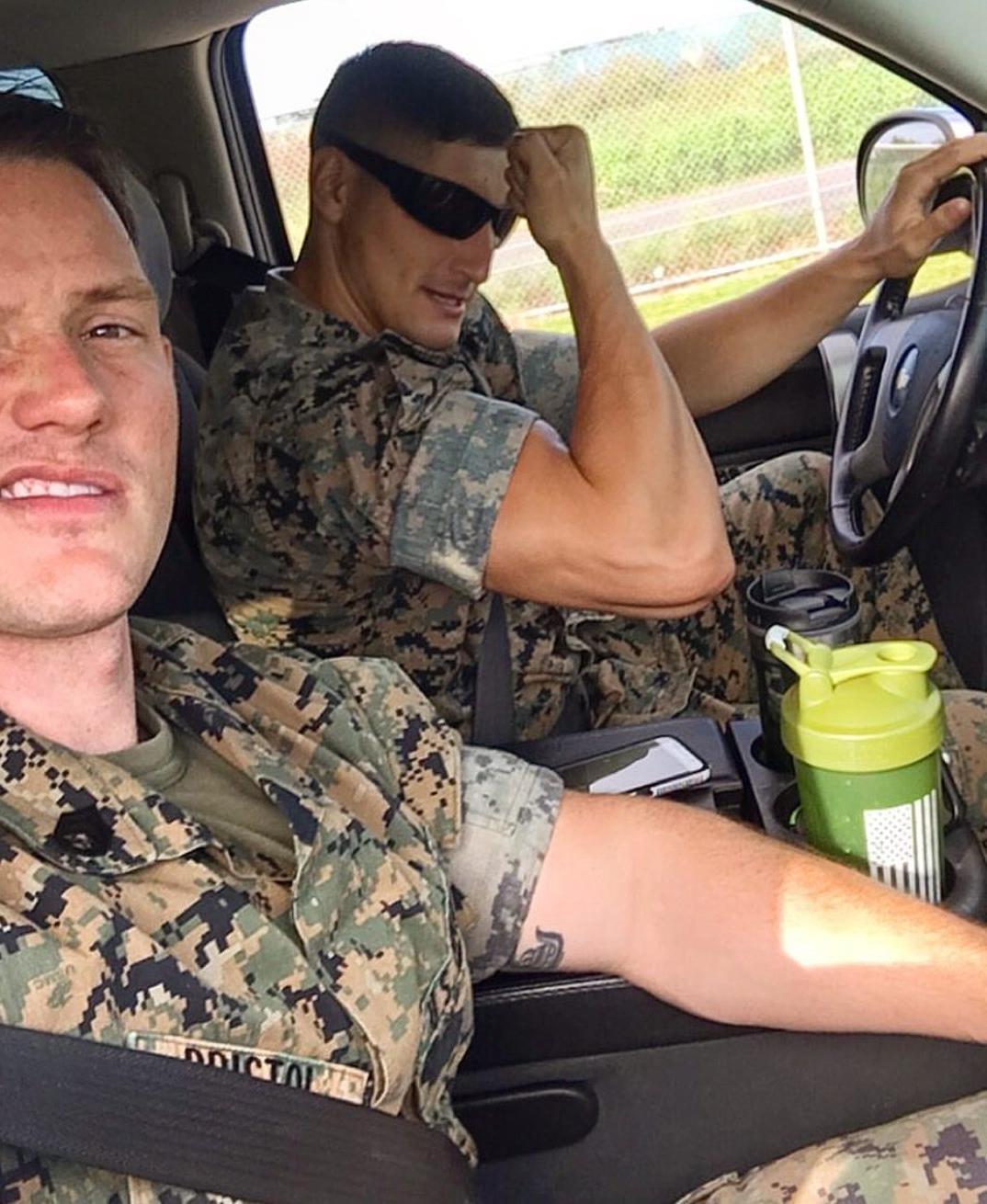 two-handsome-military-uniform-men-bicep-flex-car-ride-fun-male-soldiers