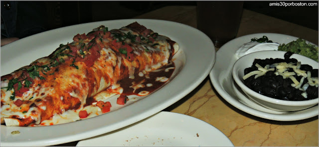 Factory Burrito Grande: A Monster Burrito with Chicken, Cheese, Cilantro Rice, Onions and Peppers. Served with Guacamole, Sour Cream, Salsa and Black Beans.
