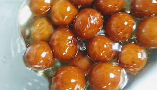 Soaked gulab jamun in sugar syrup