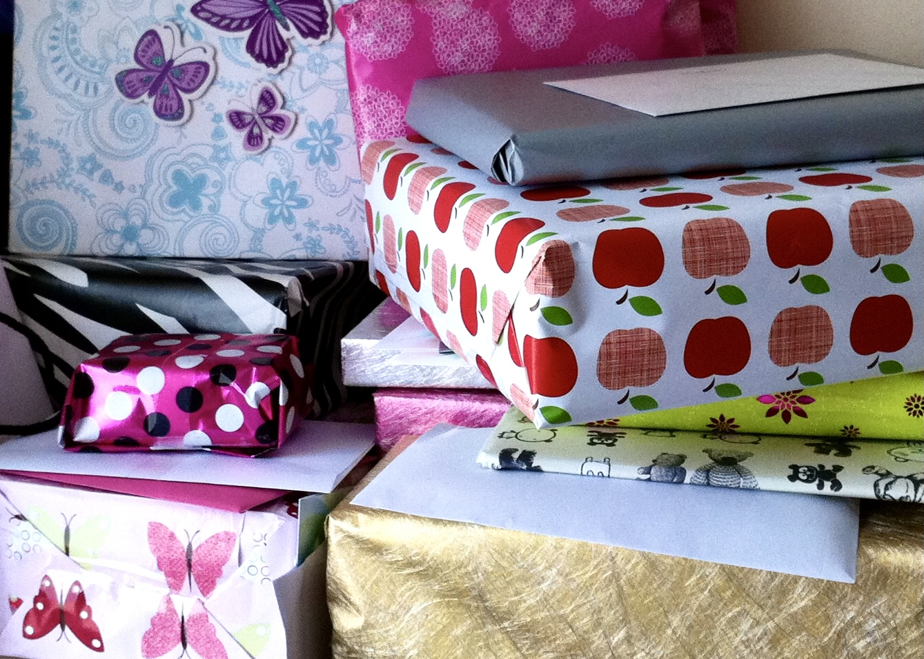 A pile of presents in different wrapping papers all chosen specially to be perfect for a child