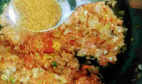 Adding spices into masala for egg bhurji
