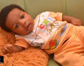 Baby at 3months staring at the camera.