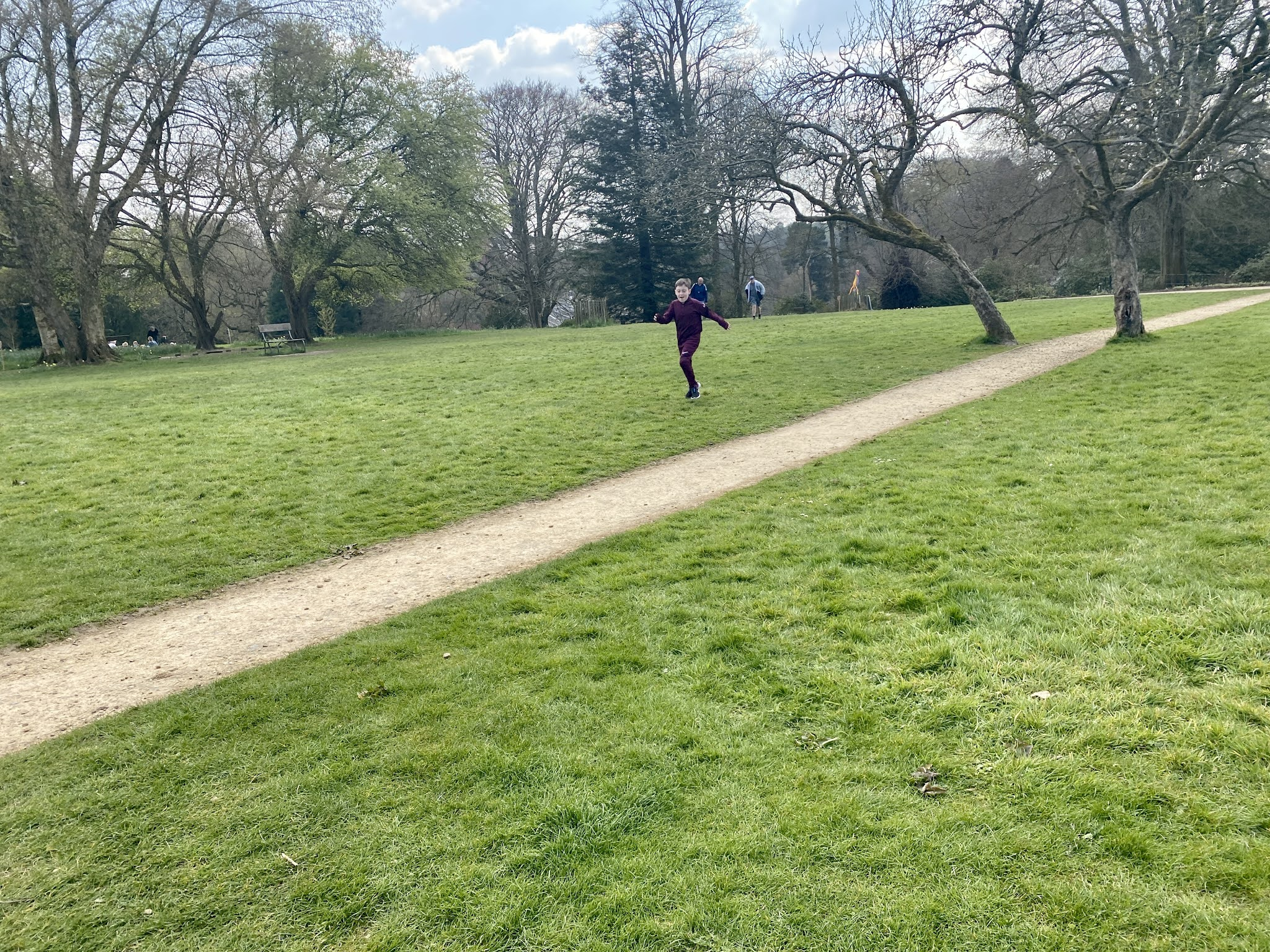 boy running on grass
