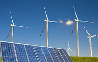 Wind farm and solar panels (Credit: Shutterstock) Click to Enlarge.