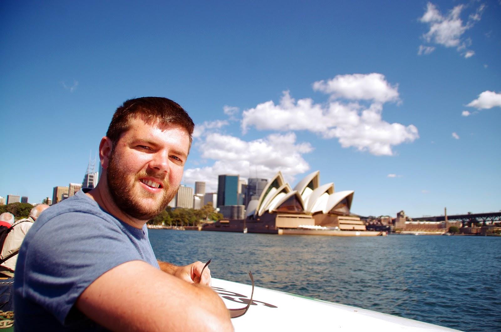 Dan on ferry cruising past the Sydney opera House