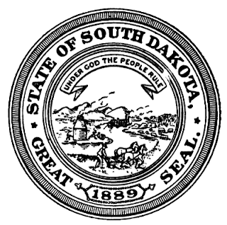Outer ring of seal contains text: State of South Dakota; Great Seal; 1889. The picture inside features hills, a river with a boat, a farmer, a mine, and cattle.
