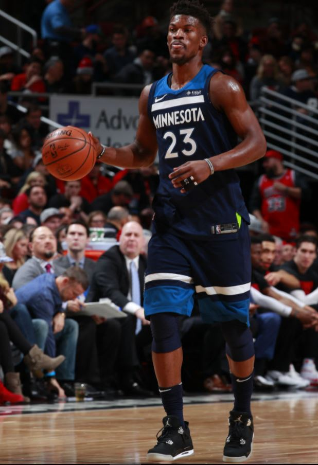 5c1a1432d28b NBA Superstar Jimmy Butler Flexing On The Court Wearing Air Jordan 4 Eminem  Carhartt Retro Sneakers During Game