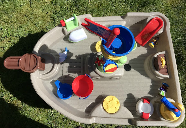 Pirate water table set up with water and toys in