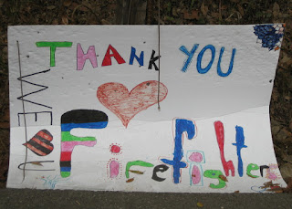 "Hand-drawn and colored sign: ""Thank You Firefighters, We ♡ U"", Pacific Coast Highway near Big Sur, California"