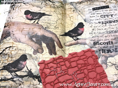 creating the background of the page using Tim Holtz Stamps