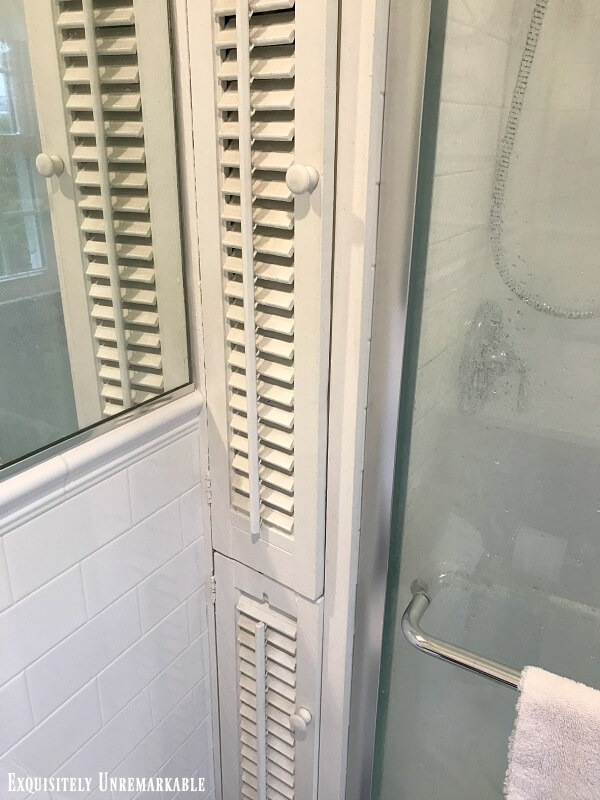 Shuttered white Cabinet Doors in the bathroom