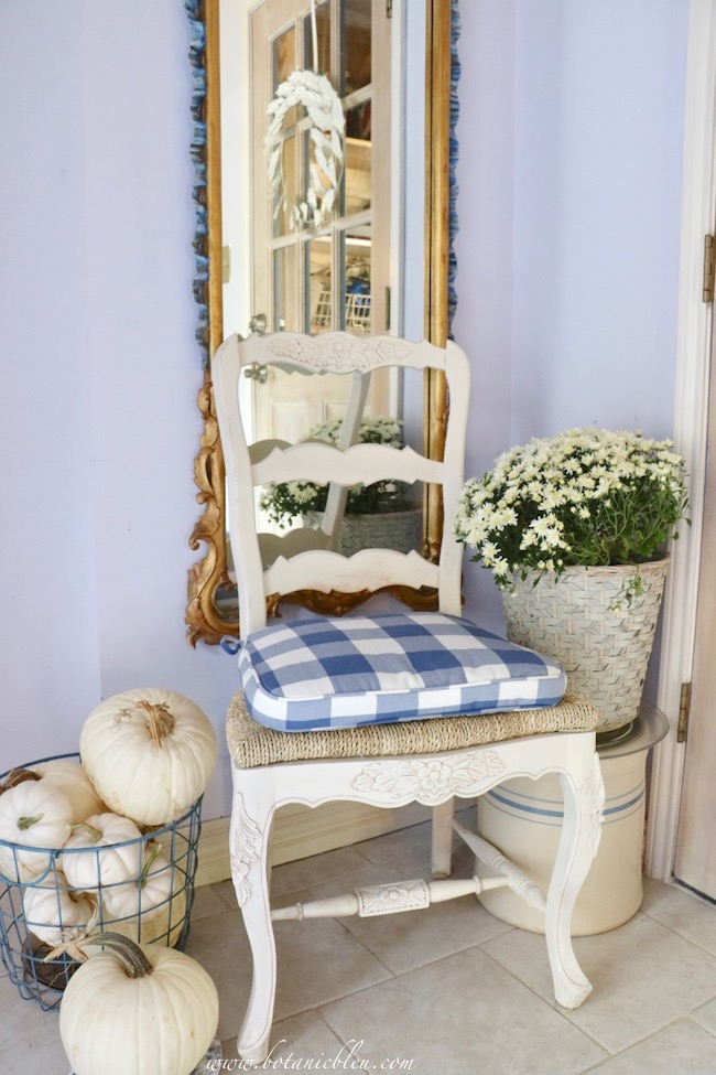 Fall blue and white cottage style small foyer lives large with vertical French Country mirror