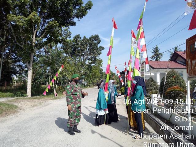 Personel Jajaran Kodim 0208/Asahan Laksanakan Gotong Royong Dengan Sasaran Pemasangan Umbul-Umbul & Bendera Merah Putih