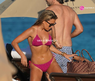 Sylvie Meis  body huge    in tiny bikini WOW Beach Side  Pics Celebs.in Exclusive 011