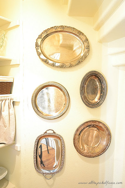 silver trays, vintage silver trays on wall
