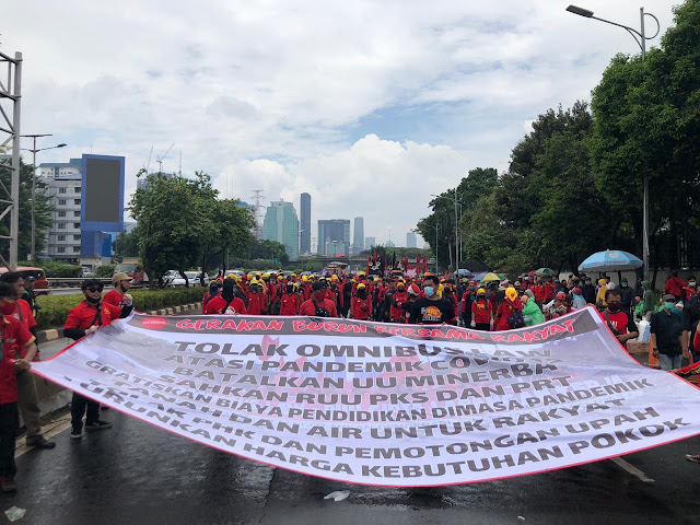 Thousands of workers and students in Indonesia stage rally against the Omnibus Law Draft Bill