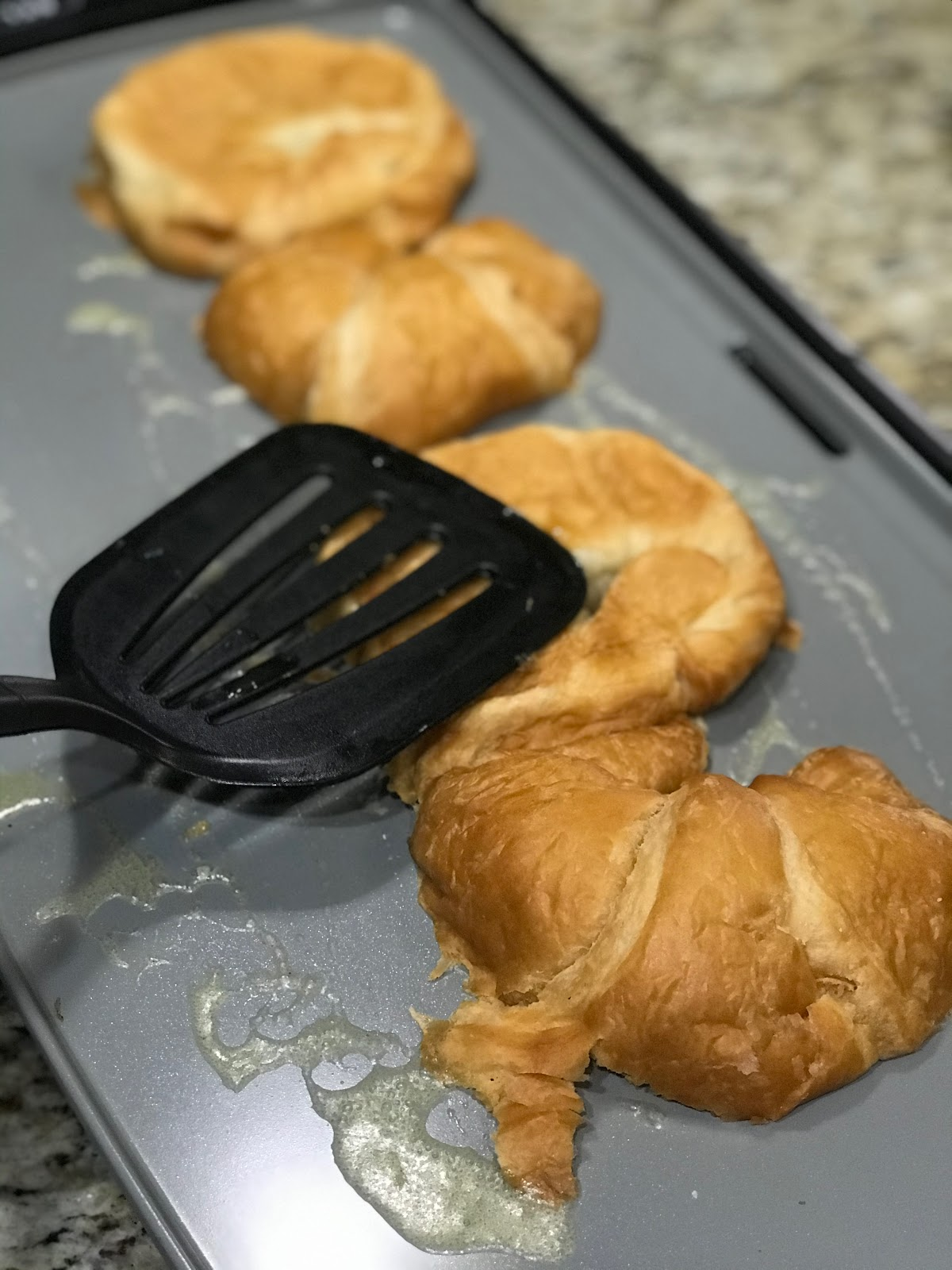 Step one is to fry croissants to make sweet fried pear sammich