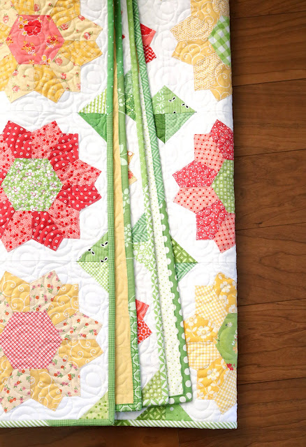Dahlia quilt - an english paper pieced quilt by Andy of A Bright Corner with a fun scrappy binding
