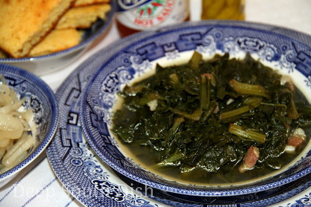 Southern style turnip greens, stewed with salt pork, beef base, a bit of sugar and cider vinegar. Serve with cornbread and pickled onions and pass the hot pepper sauces at the table.