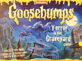 Goosebumps Terror in the Graveyard board game box art, showing the headless ghost preparing to strike.