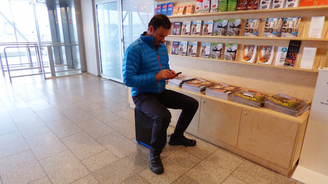 Simon Heyes sitting on a Jurni case at the airport - MyJurni