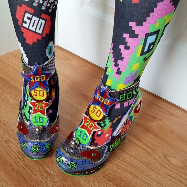 wearing colourful wedge shoes with pinball scoring theme on t-bar