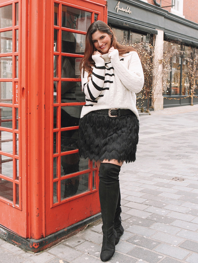 Striped and Cable knit sweater in London with phone box