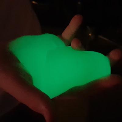 Holding glow in the dark glowing slime from Mega Dino Egg Zuru Toys