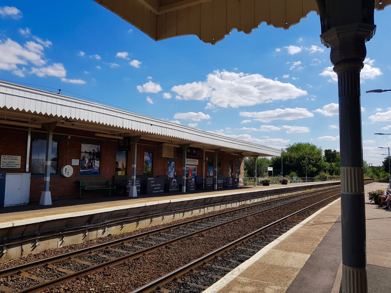 train station platform with blue sky behind