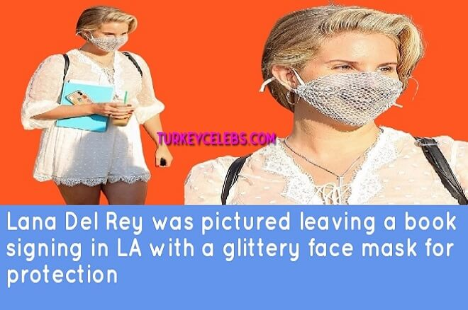 Lana Del Rey was pictured leaving a book signing in LA with a glittery face mask .