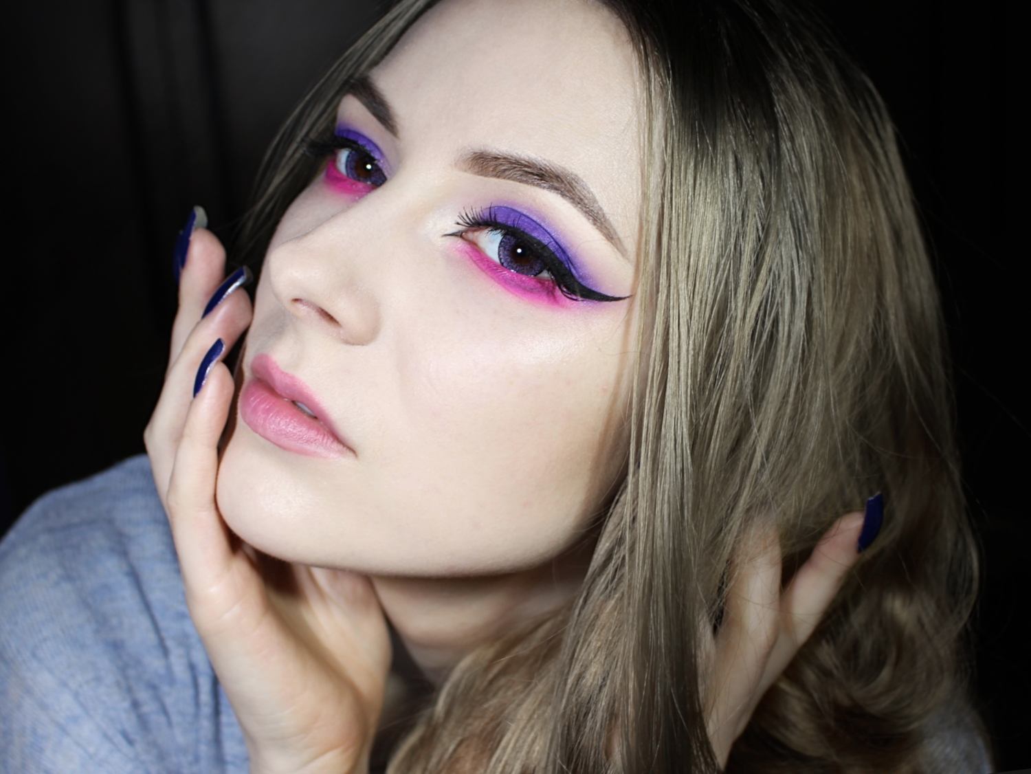 girl with beautiful purple and pink cat eye makeup look with enlarging circle lenses