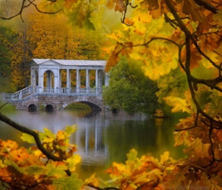 A white marble building by a lake in St. Petersburg, Russia