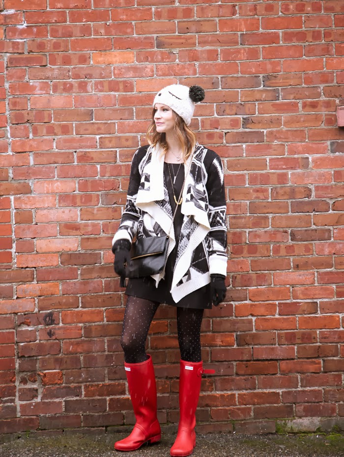 Vancouver fashion blogger, Alison Hutchinson, is wearing a Chicnova sweater, Love shift dress, red hunter boots and an Urban Outfitters teddy bear beanie