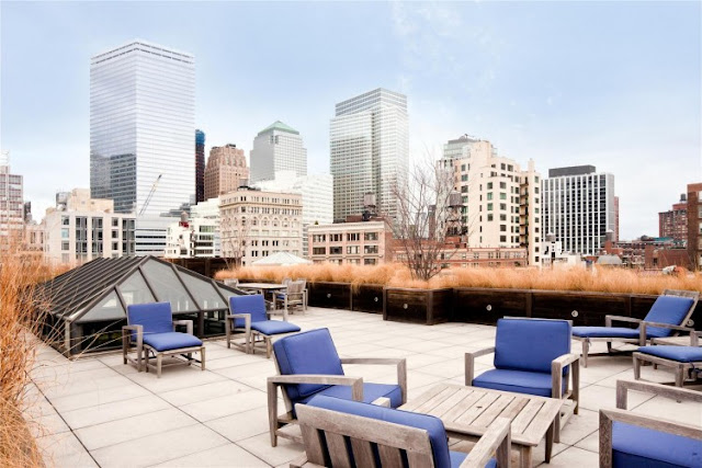 Photo of rooftop terrace with garden furniture in the Tribeca triplex
