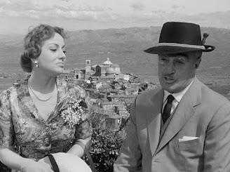 Merlini starred with Vittorio De Sica (right) in Tempo di Villeggiatura in 1956