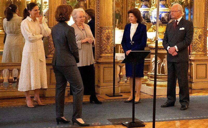 Queen Silvia and Princess Christina. Crown Princess Victoria wore a sheer lace shirt dress and baroque pearl earrings from Cravingfor