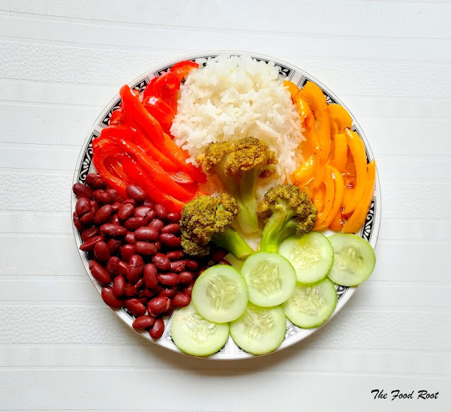 Rainbow Buddha Bowl : This satisfying bowl of goodness is filled with rice, red kidney beans, broccoli, bell peppers and cucumber.