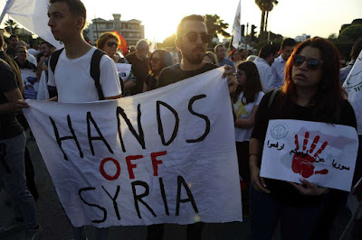 Antiwar activists and Syrians worldwide protested the joint airstrikes by allies U.K, U.S and France against Syria. The nations defend their decision to bomb the war-torn nation - reprisal for the chemical attack on Syrians allegedly by their President, Bashar al-Assad.