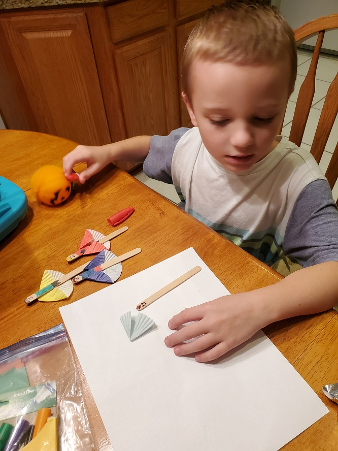 this is Antonio making superhero with sticks and markers