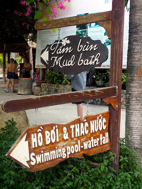 Mud bath and swimming pool sign post in Thap Ba spa, near Nha Trang, Vietnam